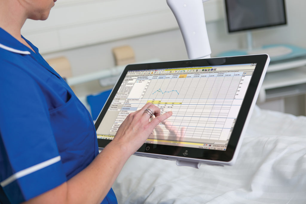 Nurse using bed side terminal