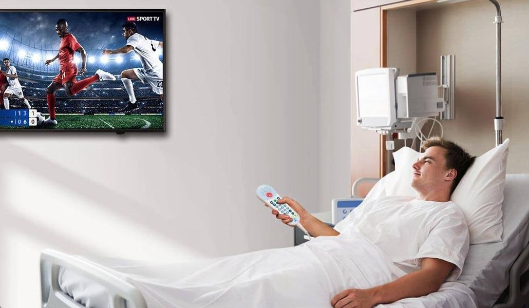 Male patient watching TV Screen in hospital room